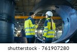 male industrial worker and... | Shutterstock . vector #761907280