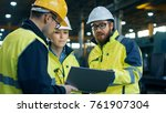 three industrial engineers talk ... | Shutterstock . vector #761907304