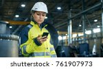 female industrial worker in the ... | Shutterstock . vector #761907973