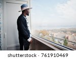 rich african man looking at... | Shutterstock . vector #761910469