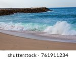 wave on the sand beach... | Shutterstock . vector #761911234
