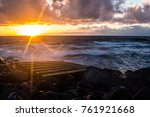 the sun is setting on the... | Shutterstock . vector #761921668