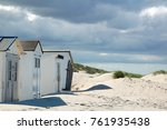little beach cabins at a north... | Shutterstock . vector #761935438