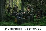 Military Staging Area, Chief Engineer Uses Radio and Army Grade Laptop. Forest Operation/ Mission in Progress. - stock photo