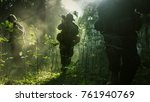 Fully Equipped Soldiers Wearing Camouflage Uniform Attacking Enemy, Rifles Ready to Shoot. Military Operation in Action, Squad Running in Formation Through Dense Smokey Forest. - stock photo