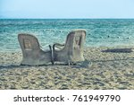couple of sunbed chairs on... | Shutterstock . vector #761949790