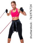 Small photo of Strong woman using a resistance band in her exercise routine. Young woman performs fitness exercises on white background.