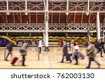 Small photo of Anonymous people on a busy train station platform