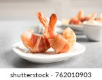 plate with shrimps wrapped in... | Shutterstock . vector #762010903
