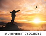 silhouette of successful man on ... | Shutterstock . vector #762028363