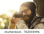photographer with vintage photo ... | Shutterstock . vector #762033496