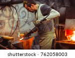 Blacksmith Working On An Anvil