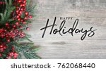 happy holidays text with... | Shutterstock . vector #762068440