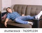 the sleeping young man on the... | Shutterstock . vector #762091234