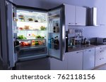 open refrigerator full of juice ... | Shutterstock . vector #762118156