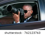 private detective sitting... | Shutterstock . vector #762123763