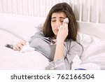 unhappy woman touching head...   Shutterstock . vector #762166504