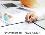 businessmen are checking the... | Shutterstock . vector #762173314