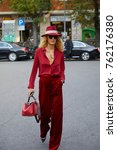 Small photo of MILAN - SEPTEMBER 22: Elina Halimi with red velvet trousers and hat before Giorgio Armani fashion show, Milan Fashion Week street style on September 22, 2017 in Milan.