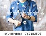 doctor pushing button key... | Shutterstock . vector #762183508