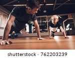 father and son in the gym.... | Shutterstock . vector #762203239