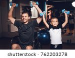 father and son in the gym.... | Shutterstock . vector #762203278
