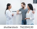 a man and a woman came to see a ... | Shutterstock . vector #762204130