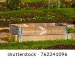 stacked pallet collars in garden | Shutterstock . vector #762241096