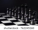 black chess figures on board.... | Shutterstock . vector #762245260