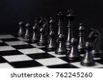 black chess figures on board.... | Shutterstock . vector #762245260