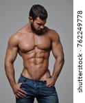 muscled male model in studio   Shutterstock . vector #762249778