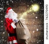 santa claus happily releasing... | Shutterstock . vector #762270490