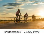 Group Of  Men Ride  Bicycles A...