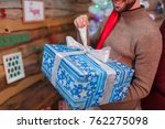 the happy guy opens his gift... | Shutterstock . vector #762275098