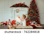 little boy on a christmas day | Shutterstock . vector #762284818