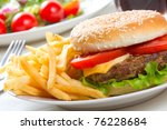 hamburger with fries and salad   Shutterstock . vector #76228684