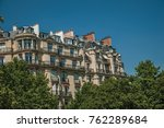building amidst trees and sunny ... | Shutterstock . vector #762289684