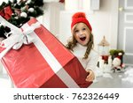 happy girl holding a big box... | Shutterstock . vector #762326449