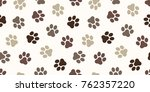 Stock vector cat paw dog paw kitten puppy foot print vector seamless pattern wallpaper background 762357220