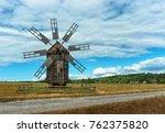 Small photo of Ancient wooden mill in the autumn field. Ukraine, Kiev, Porogovo