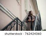 business woman walking on street | Shutterstock . vector #762424360