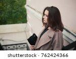 business woman walking on street | Shutterstock . vector #762424366