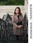 business woman walking on street   Shutterstock . vector #762424378