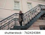 business woman walking on street   Shutterstock . vector #762424384