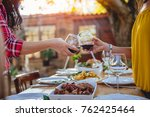 women friends toasting red wine ... | Shutterstock . vector #762425464