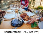 woman serving barbecue meat on...   Shutterstock . vector #762425494