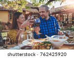 men and woman toasting with red ...   Shutterstock . vector #762425920