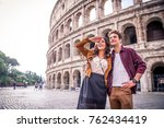 young couple at the colosseum ... | Shutterstock . vector #762434419