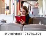 young happy woman sitting in... | Shutterstock . vector #762461506