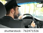 handsome man driving taxi | Shutterstock . vector #762471526
